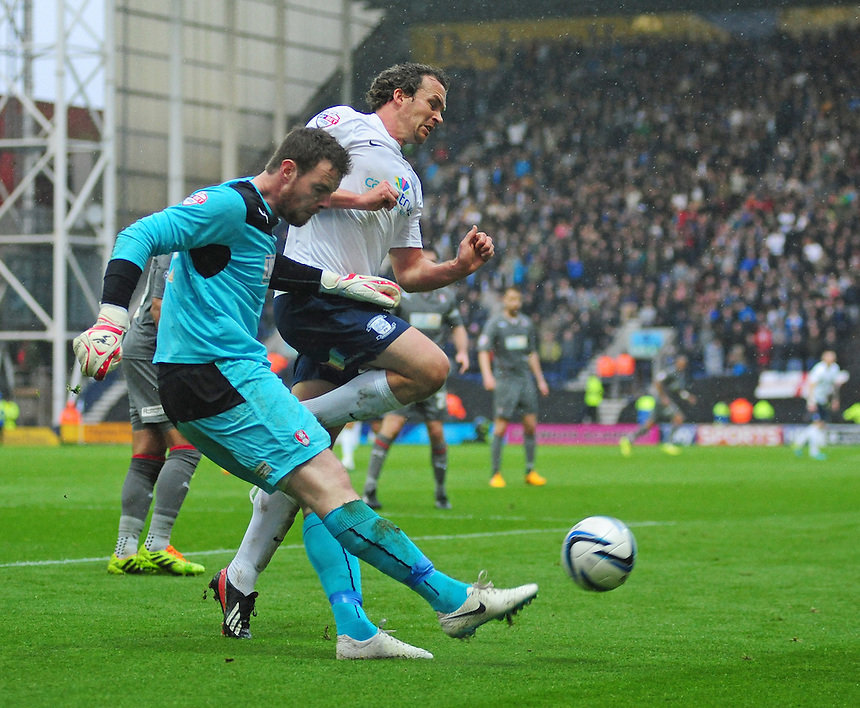 Rotherham United's Adam Collin clears under pressure from Preston North End's Kevin Davies <br /> <br /> Photographer Chris Vaughan/CameraSport<br /> <br /> Football - The Football League Sky Bet League One Play-Off First Leg - Preston North End v Rotherham United - Saturday 10th May 2014 - Deepdale - Preston<br /> <br /> &copy; CameraSport - 43 Linden Ave. Countesthorpe. Leicester. England. LE8 5PG - Tel: +44 (0) 116 277 4147 - admin@camerasport.com - www.camerasport.com