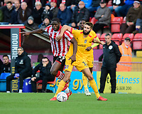 Lincoln City's John Akinde vies for possession with Northampton Town's Jordan Turnbull<br /> <br /> Photographer Chris Vaughan/CameraSport<br /> <br /> Emirates FA Cup First Round - Lincoln City v Northampton Town - Saturday 10th November 2018 - Sincil Bank - Lincoln<br />  <br /> World Copyright &copy; 2018 CameraSport. All rights reserved. 43 Linden Ave. Countesthorpe. Leicester. England. LE8 5PG - Tel: +44 (0) 116 277 4147 - admin@camerasport.com - www.camerasport.com