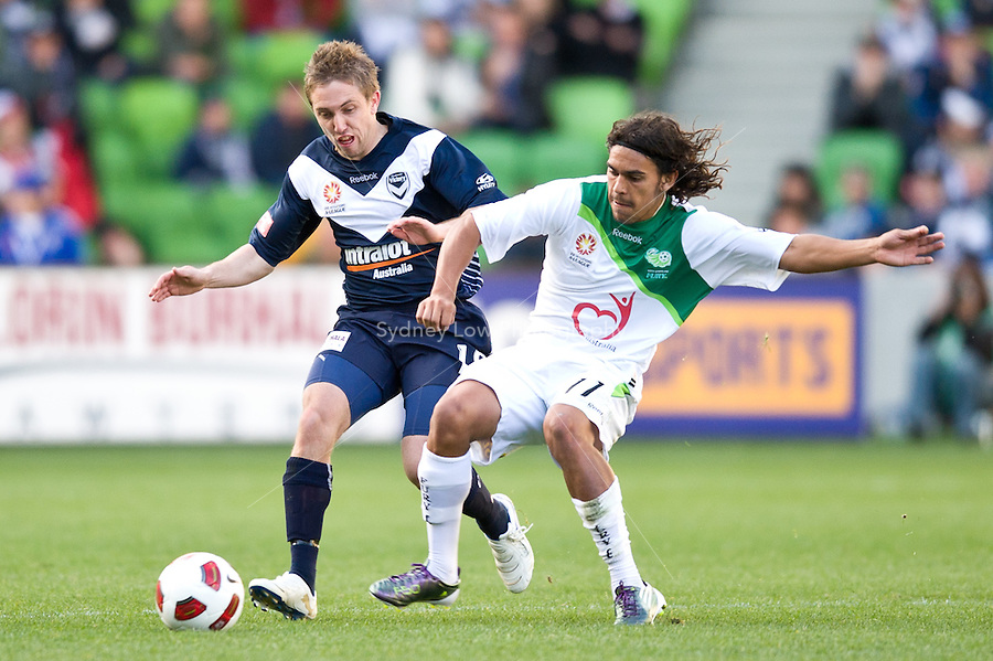 MELBOURNE, AUSTRALIA - AUGUST 22, 2010: Evan Berger from the Victory and David Williams from the Fury fight for the ball in Round 3 of the 2010 A-League between the Melbourne Victory and North Queensland Fury at AAMI Park on August 22, 2010 in Melbourne, Australia. (Photo by Sydney Low / Asterisk Images)