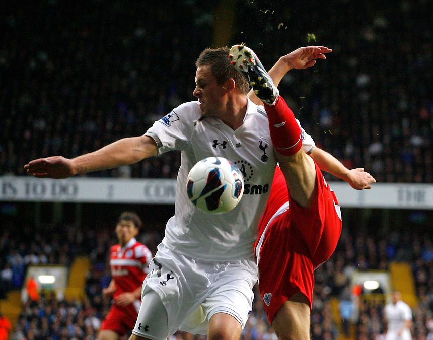 Queens Park Rangers' Clint Hill battles with Tottenham Hotspur's Gylfi Sigurdsson ..Football - Barclays Premiership - Tottenham Hotspur v Queens Park Rangers - Sunday 23rd September 2012 - White Hart Lane - London..