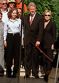 Clintons pose for a family portrait as they depart the White House for their two week vacation on August 19, 1999.  The President celebrated his 53rd birthday earlier in the day at a party thrown for him by approximately 200 members of the White House staff and volunteers on the South Lawn. (L-R) Chelsea Clinton, U.S. President Bill Clinton, First Lady Hillary Rodham Clinton..Credit: Ron Sachs / CNP