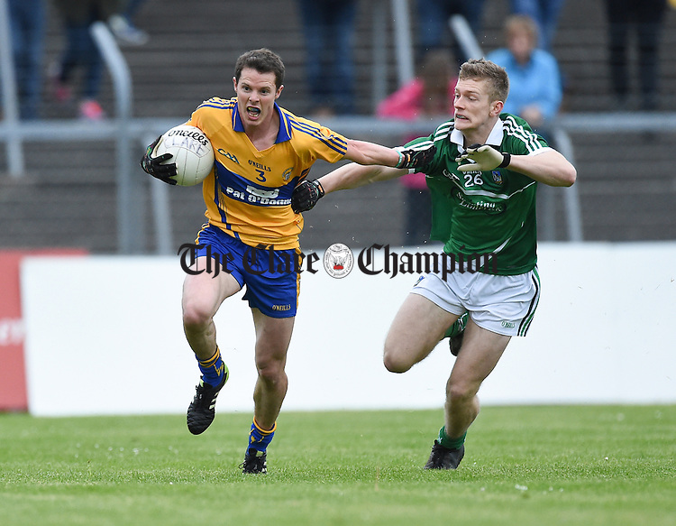 Kevin Hartnett of Clare in action against Kevin Moore of Limerick during their Championship game in Ennis. Photograph by John Kelly.