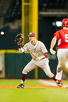 First baseman Jacob House #27 of the Texas A&M Aggies waits for a throw as Codey Morehouse #5 of the Houston Cougars hustles down the line at Minute Maid Park on March 6, 2011 in Houston, Texas.  Photo by Brian Westerholt / Four Seam Images