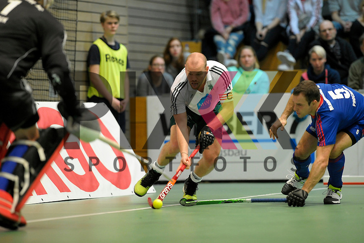 GER - Luebeck, Germany, February 06: During the 1. Bundesliga Herren indoor hockey semi final match at the Final 4 between Uhlenhorst Muelheim (white) and Mannheimer HC (blue) on February 6, 2016 at Hansehalle Luebeck in Luebeck, Germany.  Final score 2-3 (HT 7-5).  Thilo Stralkowski #11 of HTC Uhlenhorst Muehlheim, Tomas Prochazka #5 of Mannheimer HC<br /> <br /> Foto &copy; PIX-Sportfotos *** Foto ist honorarpflichtig! *** Auf Anfrage in hoeherer Qualitaet/Aufloesung. Belegexemplar erbeten. Veroeffentlichung ausschliesslich fuer journalistisch-publizistische Zwecke. For editorial use only.