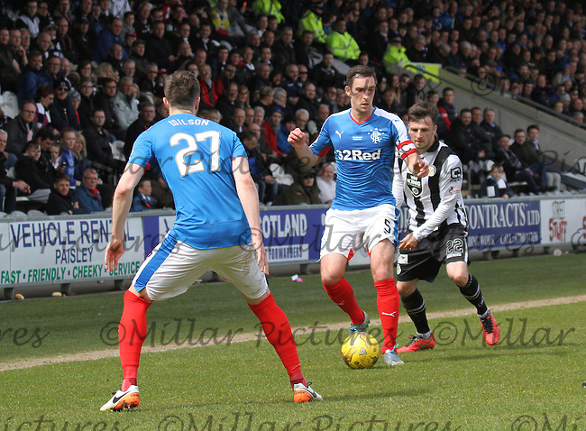 Lee Wallace passes back to Danny Wilson under pressure from Calum Gallagher in the St Mirren v Rangers Scottish Professional Football League Ladbrokes Championship match played at the Paisley 2021 Stadium, Paisley on 1.5.16.
