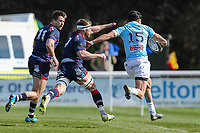 Elliot Clement-Hill of Bedford Blues (right) gets away from Joe Atkinson of London Scottish (centre) during the Greene King IPA Championship match between London Scottish Football Club and Bedford Blues at Richmond Athletic Ground, Richmond, United Kingdom on 25 March 2017. Photo by David Horn / PRiME Media Images.