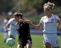 Tina DiMartino (5) controls the ball against Lisa Sari (12). Los Angeles Sol defeated FC Gold Pride 2-0 at Buck Shaw Stadium in Santa Clara, California on May 24, 2009.