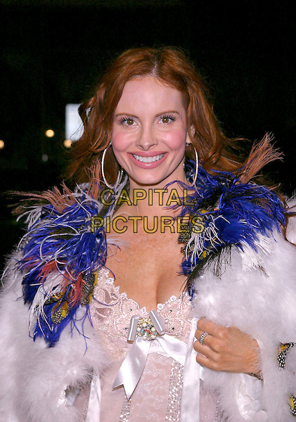 "PHEOBE PRICE.2004 AFI Fest Los Angeles presents the North American Premiere of ""A Very Long Engagement"" held at the Mann's Chinese Theatre, Hollywood, California, USA,.10th November 2004  .half length white beaded dress satin ribbon bow fluffy fur jacket coat blue feathers.Ref: ADM.www.capitalpictures.com.sales@capitalpictures.com.©JW/AdMedia/Capital Pictures ."