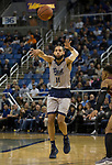 Nevada forward Cody Martin (11) passes the ball against Little Rock in the second half of an NCAA college basketball game in Reno, Nev., Friday, Nov. 16, 2018. (AP Photo/Tom R. Smedes)