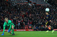 30th October 2019; Anfield, Liverpool, Merseyside, England; English Football League Cup, Carabao Cup, Liverpool versus Arsenal; Caoimhin Kelleher of Liverpool celebrates in front of the Kop after making his decisive penalty shootout save from Dani Ceballos of Arsenal - Strictly Editorial Use Only. No use with unauthorized audio, video, data, fixture lists, club/league logos or 'live' services. Online in-match use limited to 120 images, no video emulation. No use in betting, games or single club/league/player publications