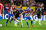 Atletico de Madrid's players Antoine Griezmann and Yannick Carrasco and Bayern Munich's player Xabi Alonso during match of UEFA Champions League at Vicente Calderon Stadium in Madrid. September 28, Spain. 2016. (ALTERPHOTOS/BorjaB.Hojas)