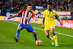 Atletico de Madrid Koke Resurrección and UD Las Palmas Jonathan Viera during La Liga match between Atletico de Madrid and UD Las Palmas at Vicente Calderon Stadium in Madrid, Spain. December 17, 2016. (ALTERPHOTOS/BorjaB.Hojas)