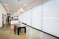 White kitchen/dining room with shades