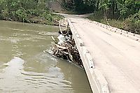 Courtesy photo/McDonald County Press<br /> The McDonald County Road Department crews have cleared the trees and debris under the Elk Springs Bridge over the Elk River. Storm winds and flooding waters pushed the trees and debris under the bridge last week.