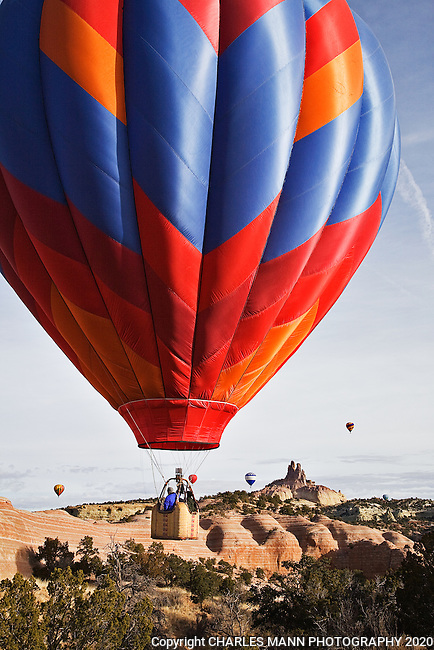 The Red Rock Balloon Rally is held each December in Gallup, New Mexico, and features hot air balloons flying against a dramatic backdrop of red sandstone walls and  colorful desert scenery.