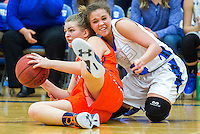 NWA Democrat-Gazette/JASON IVESTER<br /> Brooke Menke (left), Rogers Heritage sophomore, tries to pass while being defended by Rogers High junior Mykelle Williams on Tuesday, Jan. 12, 2016, at Rogers High.