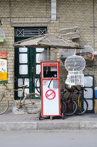 Africa, Tunisia, Tozeur. Typical small petrol station for motorbikes in Tozeur. --- No releases available, but releases may not be needed for certain uses. Automotive trademarks are the property of the trademark holder, authorization may be needed for some uses.