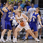 RAPID CITY, SD - MARCH 18, 2017 -- Sadie Roth #40 of Harrisburg works between Sioux Falls O'Gorman defenders Courtney Baruth #41 and Rylee Benson #5 during the 2017 South Dakota State Class AA Girls Basketball Championship game Saturday at Barnett Arena in Rapid City, S.D.  (Photo by Dick Carlson/Inertia)