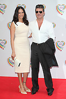 Simon Cowell and Lauren Silverman arriving for the Health Lottery Tea Party, The Savoy, London. 02/06/2014 Picture by: Alexandra Glen / Featureflash