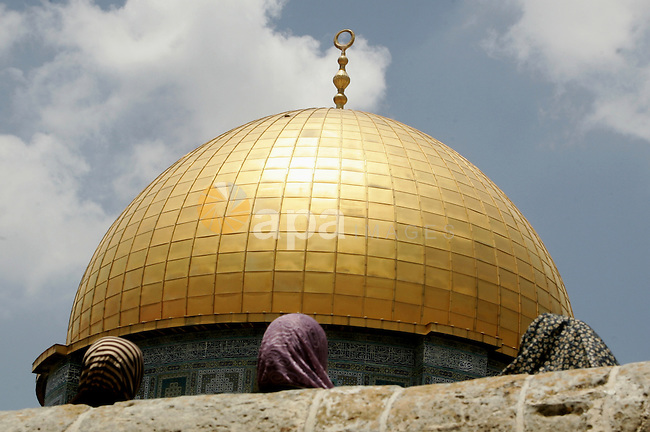 Palestinian Muslim women sit in front the Dome of Rock during Friday prayers in the Al Aqsa Mosque compound, also known to Jews as the Temple Mount, in Jerusalem's old city on May 28, 2010. Photo by Mahfouz Abu Turk