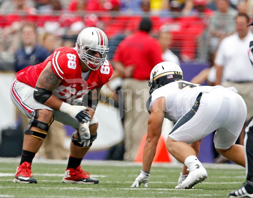 Ohio State Buckeyes offensive linesman Taylor Decker (68) against Navy Midshipmen in their NCAA game at M&T Bank Stadium in Baltimore, Maryland on August 30, 2014. (Dispatch photo by Kyle Robertson)