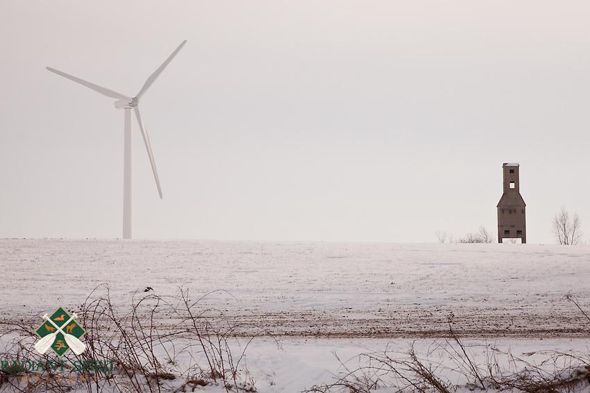 &quot;Generations Apart (Winter)&quot;<br /> <br /> A modern windmill dwarfs the old grain elevator.