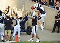 Sept. 19, 2009; Provo, UT, USA; BYU Cougars running back (11) Manase Tonga celebrates his second quarter touchdown with teammate (88) Andrew George against the Florida State Seminoles at LaVell Edwards Stadium. Mandatory Credit: Mark J. Rebilas-