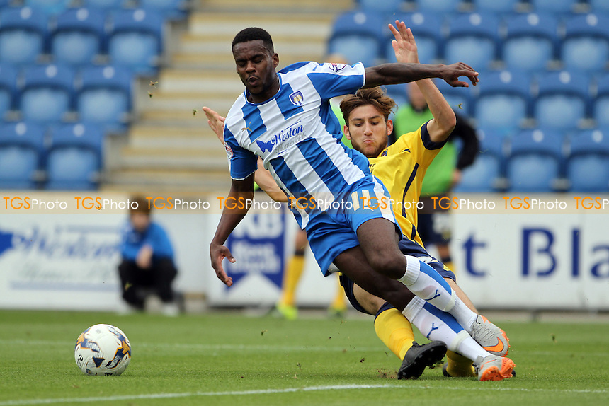 Gavin Massey of Colchester United goes down under the challenge from Charlie Goode of Scunthorpe United   during Colchester United vs Scunthorpe United, Sky Bet League 1 Football at the Weston Homes Community Stadium, Colchester, England on 29/08/2015