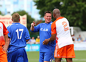 June 17th 2017, Gander Green Lane, Sutton, England; Football Charity Match; Chelsea Legends versus Rangers Legends; Players share a joke during the second half