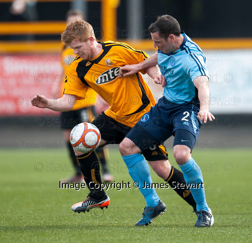 Alloa's Ryan McCord and Forfar's Mark McCulloch challenge for the ball.