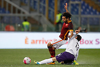 Calcio, Serie A: Roma vs Fiorentina. Roma, stadio Olimpico, 4 marzo 2016.<br /> Roma&rsquo;s Mohamed Salah, left, is tackled by Fiorentina&rsquo;s Davide Astori during the Italian Serie A football match between Roma and Fiorentina at Rome's Olympic stadium, 4 March 2016.<br /> UPDATE IMAGES PRESS/Riccardo De Luca