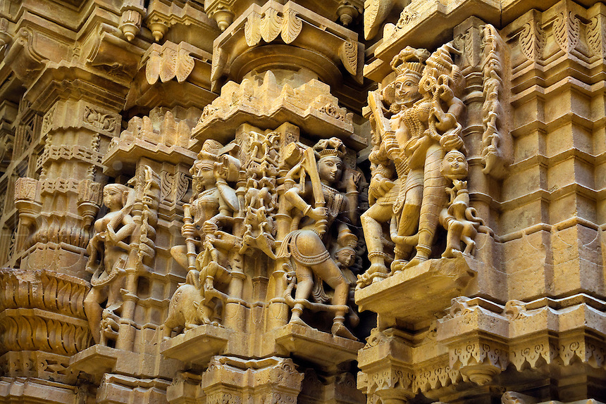 Hand carved sandstone statues of KING, his CONSORT and DEVAS in the  CHANDRAPRABHU JAIN TEMPLE inside JAISALMER FORT - RAJASTHAN, INDIA..