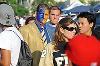 1 October 2011:  A fan, face painted blue and gold, makes his way to the stadium after tailgating prior to the game.  The Duke University Blue Devils defeated the FIU Golden Panthers, 31-27, at FIU Stadium in Miami, Florida.