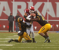 NWA Democrat-Gazette/MICHAEL WOODS • Arkansas tight end Hunter Henry cannot hold onto the ball as he is hit by Missouri defenders Aarion Penton (11) and Kentrell Brothers (10) in the first quarter of Friday's game at Razorback Stadium November 27, 2015.