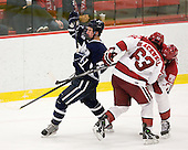 Jay Camper (UNH - 17), Colin Blackwell (Harvard - 63), Dan Ford (Harvard - 5) - The Harvard University Crimson defeated the University of New Hampshire Wildcats 7-6 on Tuesday, November 22, 2011, at Bright Hockey Center in Cambridge, Massachusetts.