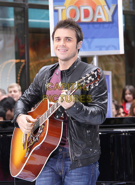 "KRIS ALLEN .American Idol winner Kris Allen performs live on NBC's ""Today Show"", New York, NY, USA, 28th May 2009..half length black leather jacket guitar playing performing on stage playing live .CAP/ADM/PZ.©Paul Zimmerman/Admedia/Capital Pictures"