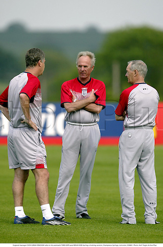 England manager SVEN GORAN ERIKSSON talks to his assistants TORD GRIP aand BRIAN KIDD during a training session, Champneys Springs, Leicester, 030601. Photo: Neil Tingle/Action Plus...2003 .football.managers coach coaches.portraits.......