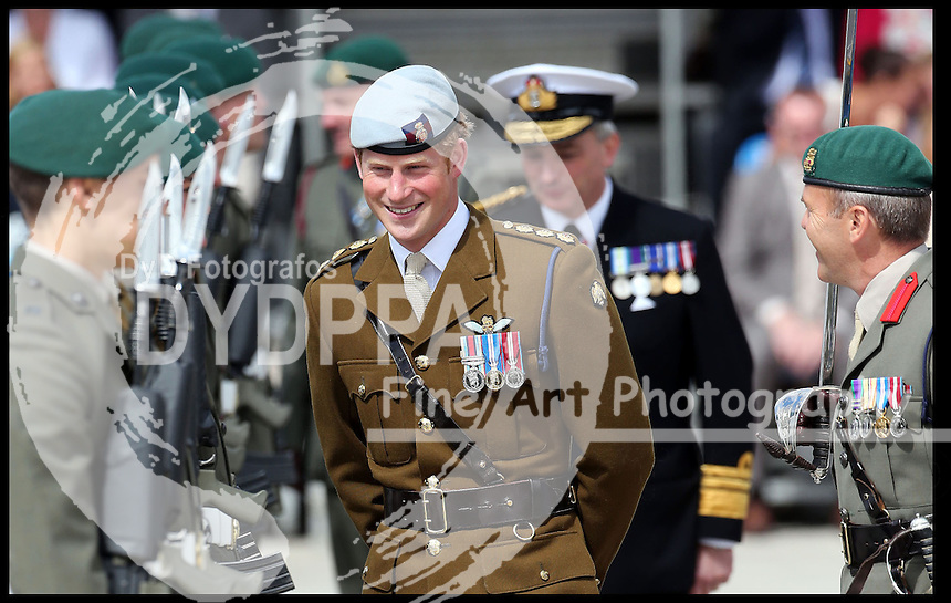 Prince Harry during a visit to the Royal Marines Tamar at the HM Naval Base in Devonport, Plymouth, Friday, 2nd August 2013<br /> Picture by Stephen Lock / i-Images<br /> Keywords : # ROYALS prince harry Royal Marines Tamar HM Naval Base Devonport Plymouth<br /> Photographer : Stephen Lock / i-Images<br /> Headline : Prince Harry visits Royal Marines in Plymouth<br /> Credit : Stephen Lock / i-Images