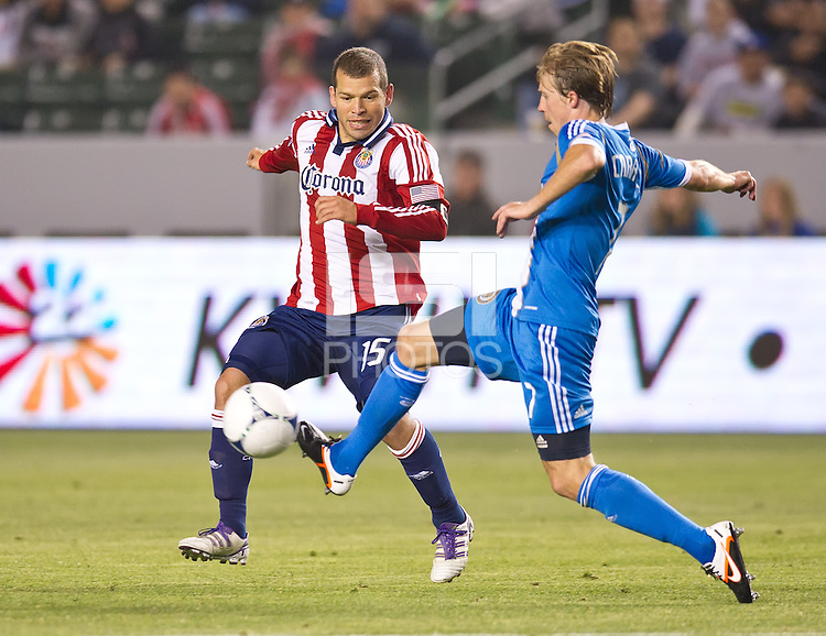 CARSON, CA - April 21, 2012: Chivas USA forward Alejandro Moreno (15) and Philadelphia Union midfielder Brain Carroll (7) during the Chivas USA vs Philadelphia Union match at the Home Depot Center in Carson, California. Final score Philadelphia Union 1, Chivas USA 0.