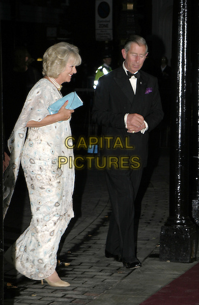 CAMILLA PARKER-BOWLES & HRH PRINCE CHARLES.Woman In White Royal Gala Performance, Palace Theatre.September 13th, 2004.full length, royalty, blue clutch purse, wallet, bag, white patterned dress, throw, shawl, scarf .www.capitalpictures.com.sales@capitalpictures.com.© Capital Pictures.