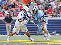 Annapolis, MD - May 20, 2018: Duke Blue Devils Brian Smyth (26) and Johns Hopkins Blue Jays Hunter Moreland (31) fight for the ball during the quarterfinal game between Duke vs John Hopkins at  Navy-Marine Corps Memorial Stadium in Annapolis, MD.   (Photo by Elliott Brown/Media Images International)