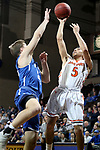 SIOUX FALLS, SD - MARCH 8:  Shane Maple #5 from Governors State shoots over Ty Hoglund #24 from Dakota Wesleyan at the 2018 NAIA DII Men's Basketball Championship at the Sanford Pentagon in Sioux Falls. (Photo by Dave Eggen/Inertia)