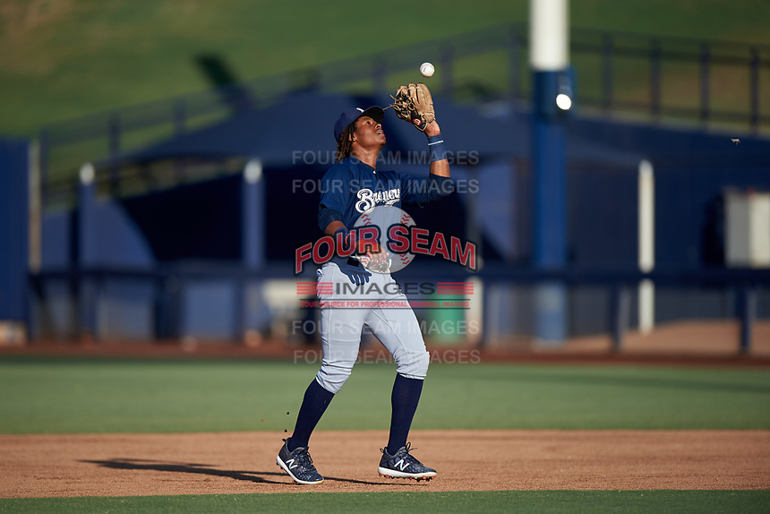 AZL Brewers Blue second baseman Orveo Saint (30) catches a pop fly during an Arizona League game against the AZL Brewers Gold on July 13, 2019 at American Family Fields of Phoenix in Phoenix, Arizona. The AZL Brewers Blue defeated the AZL Brewers Gold 6-0. (Zachary Lucy/Four Seam Images)