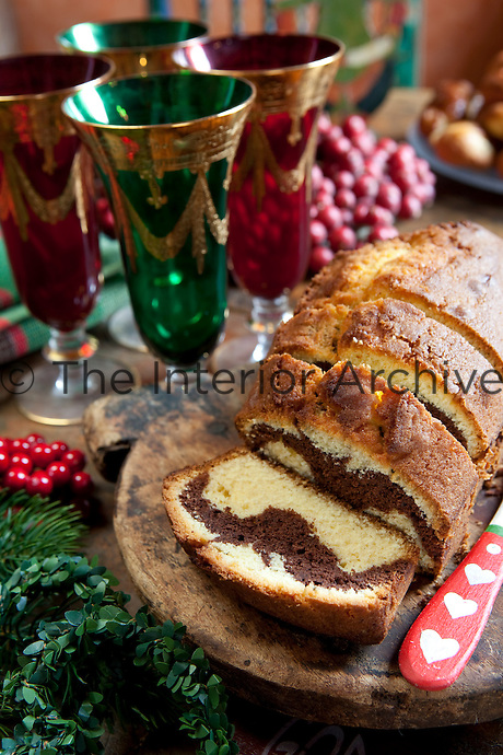 Detail of a Christmas table with freshly made marble cake and festive wine glasses