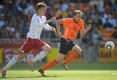 Joris Mathijsen (R) of the Netherlands vies with Nicklas Bendtner of Denmark during the 2010 FIFA World Cup group E match between the Netherlands and Denmark at Soccer City stadium in Johannesburg, South Africa, 14 June 2010.