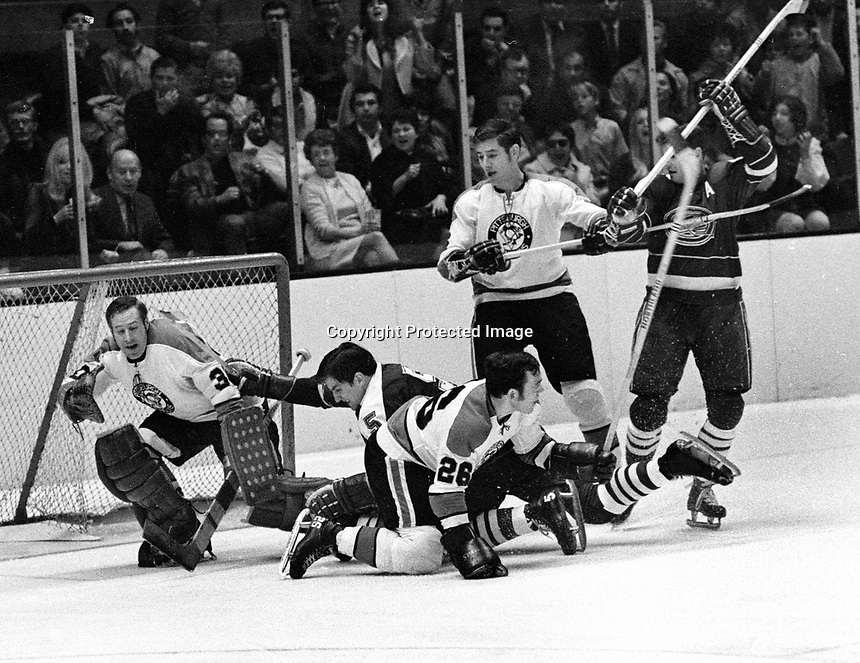Seals vs Pittsburg April 12,1970: Seals Carol Vadnais and Earl Ingarfield. Penguin goalie Les Binkley, #26 Dunc McCallum. (photo/Ron Riesterer)
