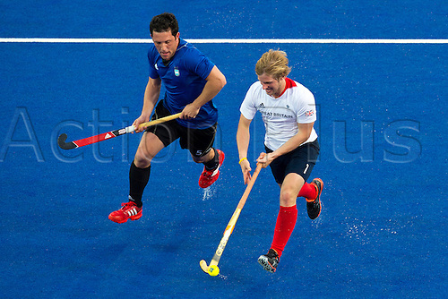 30.07.2012. London, England. Ashley Jackson (GBR) vies with Pedro Ibarra (ARG) during the Mens Hockey Preliminary between Great Britain and Argentina on Day 3 of the London 2012 Olympic Games at the Riverbank Arena on the Olympic Park. England won the game by 4-1.