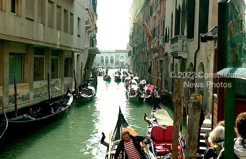Venice, Italy - March 25, 2006 --  View of a canal that leads to the Grand Canal in Venice, Italy showing boats next to homes and businesses along the water on March 25, 2006.  .Credit: Ron Sachs / CNP