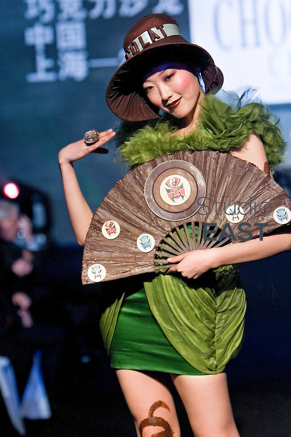 A model poses with a fan made of chocolate during Chocolate Fashion Show as part of 'Salon du Chocolat',  in Shanghai, China, on January 20, 2010. The first edition of 'Salon du chocolat' chocolate fair in Shanghai is held January 21-23, 2010. Photo by Lucas Schifres/Pictobank