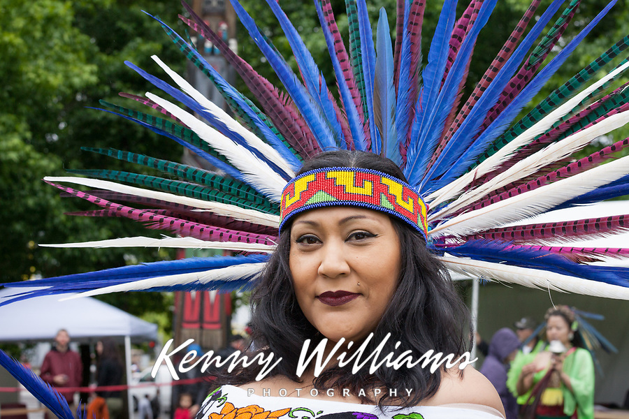 Native American woman wearing feather headdress, Northwest Folklife Festival 2016, Seattle Center, Washington, USA.